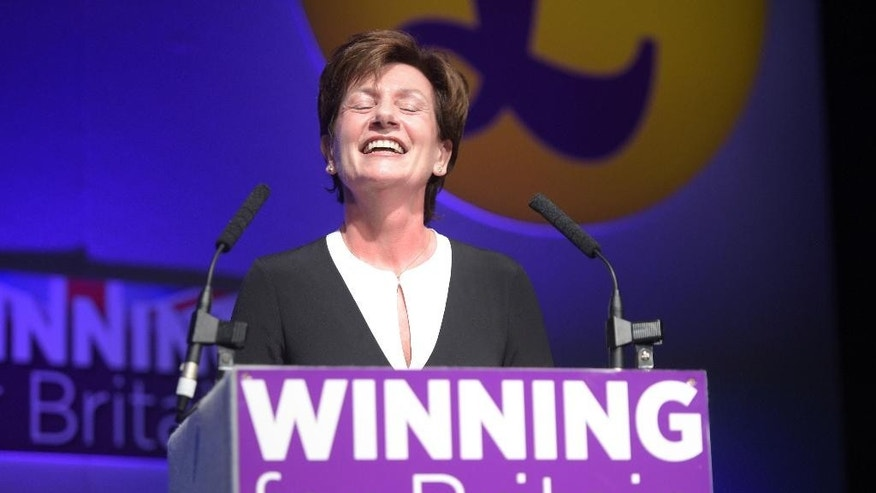 Diane James celebrates after being named as the new leader of the UK Independence Party at the party's annual conference in Bournemouth, England, Friday, Sept. 16, 2016. Britain's right-wing U.K. Independence Party has chosen European Parliament member Diane James as its leader, replacing the charismatic but divisive Nigel Farage.  James defeated four other candidates in a ballot of party members.  (Ben Birchall/PA via AP)