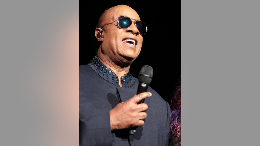 "File-This Oct. 7, 2015, file photo shows Stevie Wonder performing in concert during his ""Songs in the Key of Life Tour 2015"" in Philadelphia. Leonardo DiCaprio, Wonder, Michael Douglas and other stars pleaded for peace and the survival of the planet Friday, Sept. 16, 2016, which Secretary-General Ban Ki-moon said is ""closer to conflict than we may like to think."" (Photo by Owen Sweeney/Invision/AP, File)"