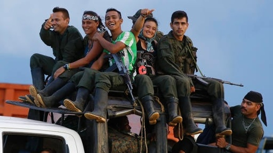 Rebels of the Revolutionary Armed Forces of Colombia (FARC) arrive to El Diamante in southern Colombia, Friday, Sept. 16, 2016. FARC rebels are gathering for a congress to discuss and vote on a peace accord reached with the Colombian government to end five decades of war. Historically secretive, this congress is the first one open to civilians. (AP Photo/Ricardo Mazalan)