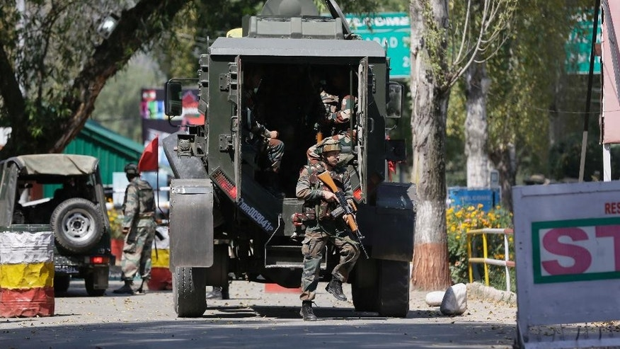 Indian army soldiers arrive at the army base which was attacked by suspected rebels in the town of Uri, west of Srinagar, Indian controlled Kashmir, Sunday, Sept. 18, 2016. Suspected rebels using guns and grenades sneaked into a crucial army base in Indian-controlled Kashmir early Sunday and killed at least 17 soldiers in the deadliest attack on a military base in the disputed Himalayan region in recent years, the army said. (AP Photo/Mukhtar Khan)