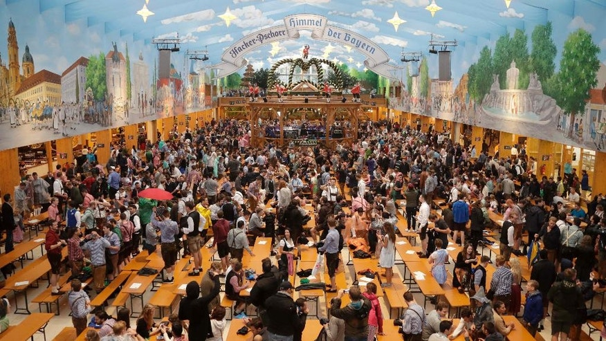 People enter a tent and wait for the opening of the 183rd Oktoberfest beer festival in Munich, southern Germany, Saturday, Sept. 16, 2016. The world's largest beer festival will be held from Sept. 16 to Oct. 3, 2016. (AP Photo/Matthias Schrader)