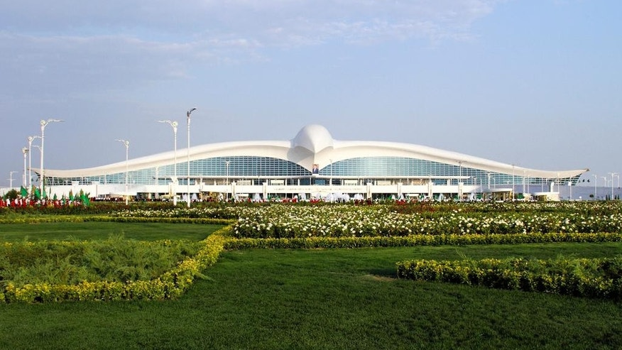 A view of the new international airport terminal outside Ashgabat, Turkmenistan, Saturday, Sept. 17, 2016. The capital of Turkmenistan, a country largely closed to outsiders, has opened a $2.3-billion terminal at its international airport in the shape of a flying falcon. The terminal, whose roof in profile resembles a bird with spread wings, adds to Ashgabat's vast array of gleaming, idiosyncratic buildings. (AP Photo)