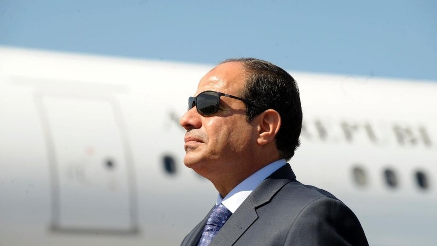 FILE - In this June 25, 2014, file photo, Egyptian President Abdel-Fattah el-Sissi stands at Algiers airport on his arrival to Algiers, Algeria. Seeking to improve the country's image, authorities in Egypt are pulling out all the stops to ensure that President Abdel-Fattah el-Sissi's visit to New York for the U.N. General Assembly is a diplomatic success. El-Sissi flew to New York Sunday, Sept. 18, 2016, with some two dozen loyal lawmakers and media figures who will be on hand to express support for the general-turned-president during his four-day stay in New York. (AP Photo/Sidali Djarboub, File)