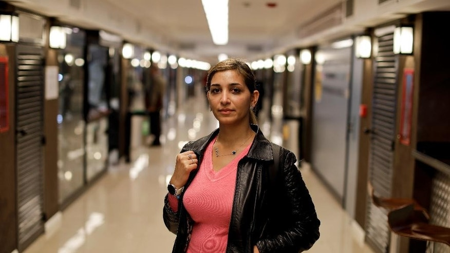 Syrian refugee Nairbouz Baloul poses for a portrait inside a subway station in Buenos Aires, Argentina, Monday, Sept. 19, 2016, where Amnesty International set up a mock-up Syrian home for commuters to visit. Argentina's President Mauricio Macri pledged earlier in the year that the country would receive 3,000 Syrian refugees escaping from war. Baloul, 29, arrived one month ago from Latakia. (AP Photo/Victor R. Caivano)