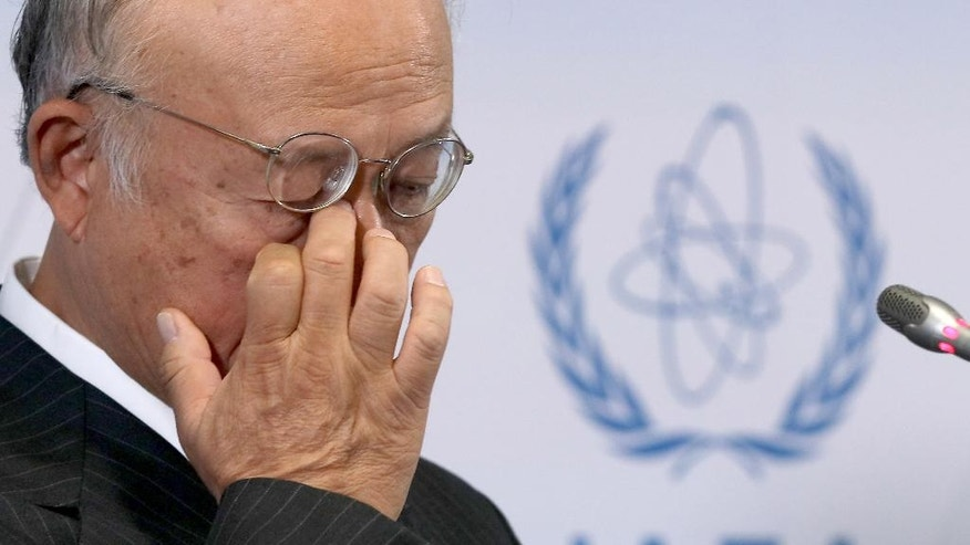 Director General of the International Atomic Energy Agency, IAEA, Yukiya Amano of Japan rubs his eye as he  addresses the media during a news conference after a meeting of the IAEA board of governors at the International Center in Vienna, Austria, Monday, Sept. 19, 2016. (AP Photo/Ronald Zak)