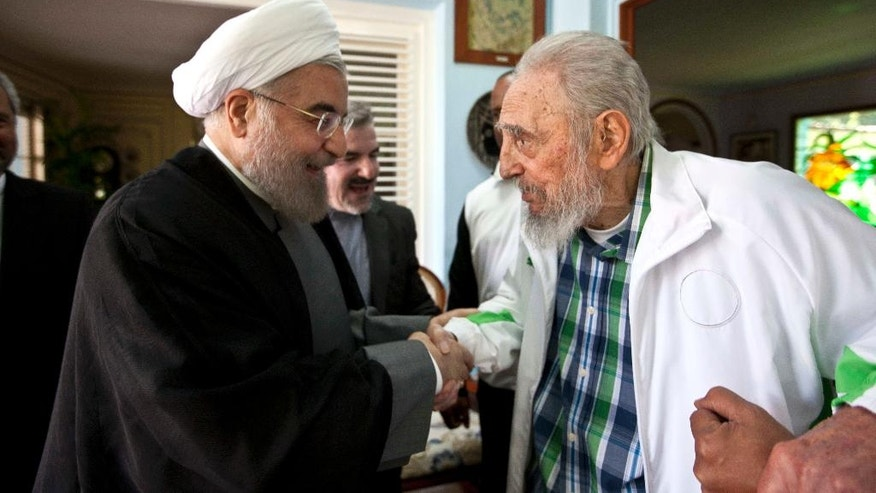 Cuba's former leader Fidel Castro, right, shakes hands with Iranian President Hassan Rouhani in Havana, Cuba, Monday, Sept 19, 2016. Rouhani is on a one-day official visit to Cuba. (AP Photo/Alex Castro)