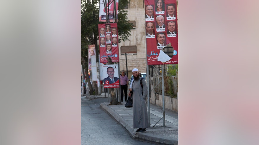 Election posters are on display in the capital, Amman, Jordan, Sunday, Sept. 18, 2016. Officials say Jordan's upcoming parliament election shows that the pro-Western monarchy is moving forward with democratic reforms, while critics argue that new voting rules have fallen short and won't deliver change. In Tuesday's vote, more than 1,200 candidates compete for 130 seats and the largest opposition group, the Muslim Brotherhood, participates for the first time in almost a decade.. (AP Photo/Raad Adayleh)