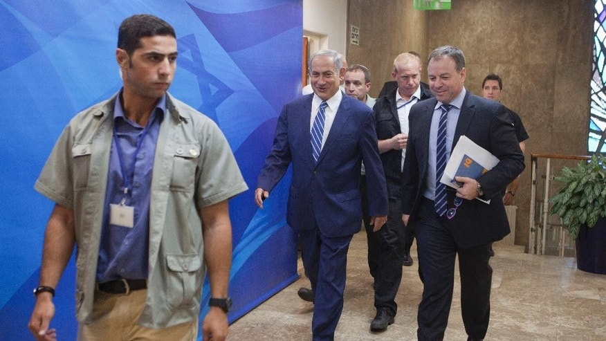 Israeli Prime Minister Benjamin Netanyahu, second left, arrives to attend a weekly cabinet meeting in Jerusalem. Sunday, Sept. 18, 2016. (AP Photo/Dan Balilty, Pool)