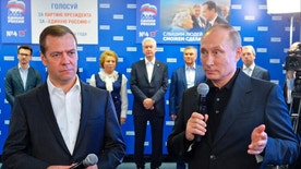 Russian President Vladimir Putin, right, and Russian Prime Minister Dmitry Medvedev, left, speak at United Party's election headquarters in Moscow, Russia, Sunday, Sept. 18, 2016. President Vladimir Putin, who formally is not a United Russia member, turned up at its election headquarters shortly after the first results were announced and congratulated the would-be lawmakers. (Alexei Druzhinin/Sputnik, Kremlin Pool Photo via AP)