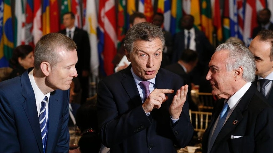 Argentina's President Mauricio Macri, center, speaks with Brazil's President Michel Temer, right, as they arrive for a luncheon during the United Nations General Assembly at United Nations headquarters Tuesday, Sept. 20, 2016. (Lucas Jackson/Pool Photo via AP)