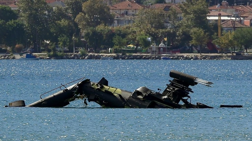 An Apache attack helicopter of the Greek army that crashed into the sea near the town of Asprovalta, northern Greece, Tuesday, Sept. 20, 2016. Greek authorities say two crew members were rescued after their helicopter suffered an engine failure and fell into the sea near the coast in northern Greece during a training exercise. (Kostas Villa/InTime News via AP)