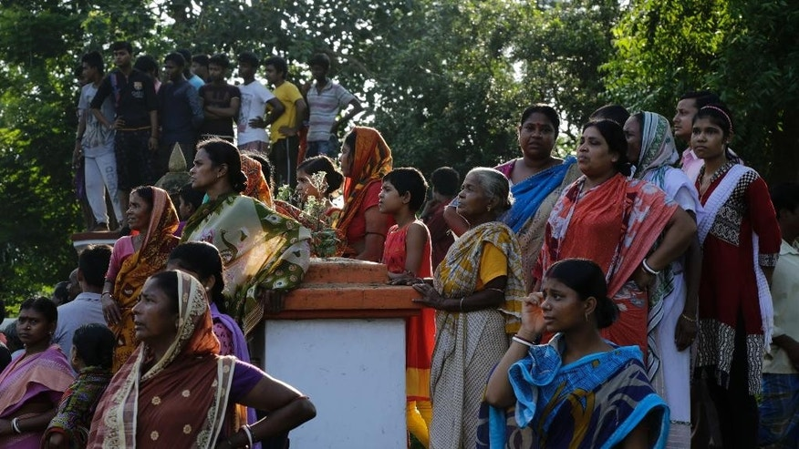 Villagers watch the cremation of Indian army soldier Gangadhar Dalai, who was killed in a militant attack in Uri, Kashmir, prior to his cremation in Jamuna Balia village, west of Kolkata, India, Tuesday, Sept. 20, 2016. Early Sunday, fighters slipped into an army base in Indian-controlled Kashmir, killing at least 15 soldiers. (AP Photo/Bikas Das)