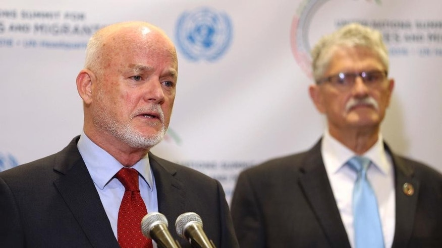 United Nations general assembly president Peter Thomson, left, speaks to reporters while former president Mogens Lykketoft listens before the start of the Summit for Refugees and Migrants at U.N. headquarters, Monday, Sept. 19, 2016. (AP Photo/Seth Wenig)