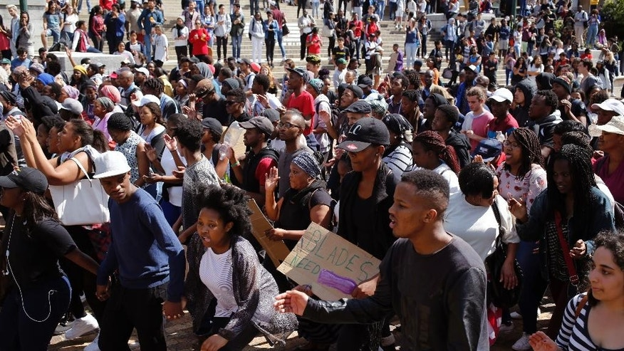 Students chant and sing at the University of Cape town as they protest for free education in Cape Town, South Africa, Tuesday, Sept. 20, 2016. Protesters also blocked entrances at the University of Cape Town, which has suspended classes on Tuesday and Wednesday because of the unrest. (AP Photo/Schalk van Zuydam)