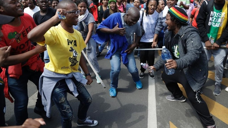 Students sing during their protest for free education in Johannesburg, South Africa, Tuesday, Sept. 20, 2016. South African university students who want free education are protesting on several campuses, and police have arrested at least 10 students who blocked an entrance at the University of the Witwatersrand in Johannesburg. (AP Photo/Themba Hadebe)