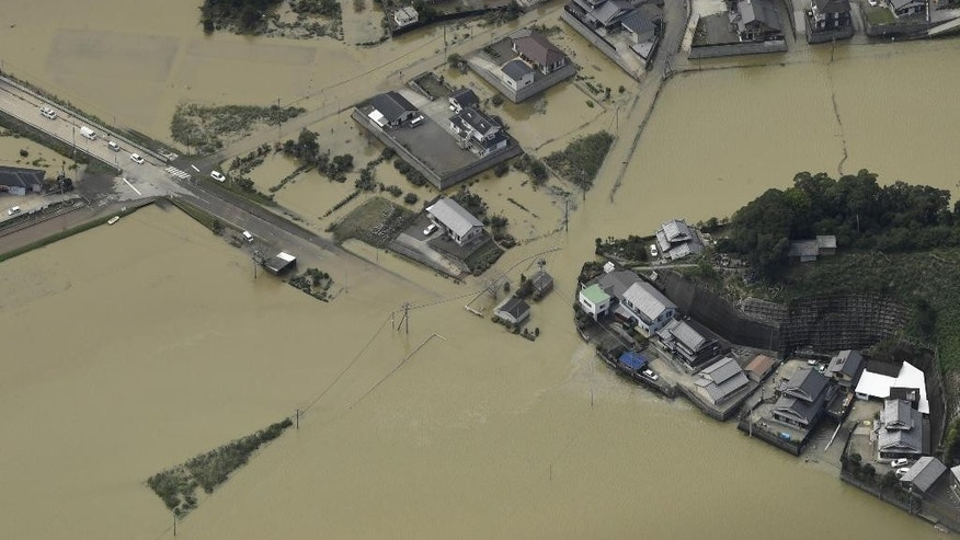 This aerial photo shows a submerged area in Nobeoka, Miyazaki prefecture, southern Japan Tuesday, Sept. 20, 2016. A powerful typhoon brought heavy rainfall in southern Japan. (Hiroko Harima/Kyodo News)