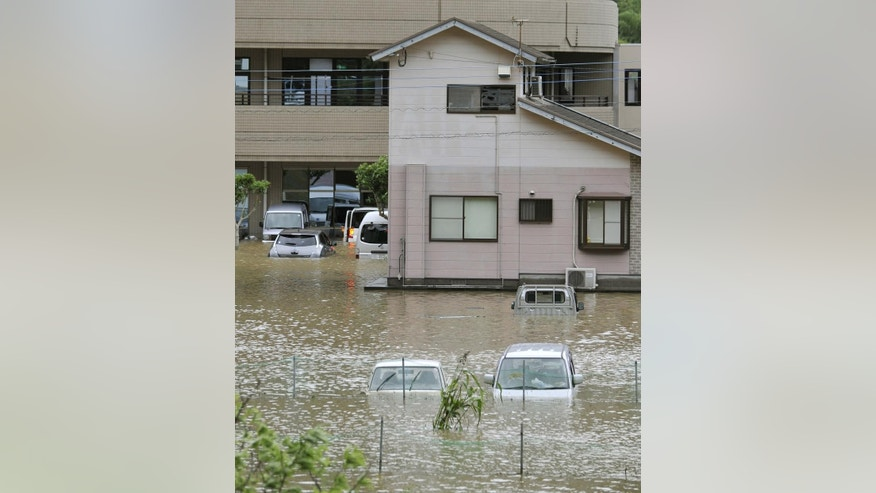 Vehicles are submerged in Nobeoka, Miyazaki prefecture, southern Japan Tuesday, Sept. 20, 2016. A powerful typhoon brought heavy rainfall in southern Japan.(Ryosuke Uematsu/Kyodo News via AP)