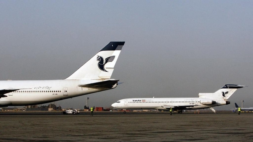 FILE -- In this March 2, 2008 file photo, two passenger planes of Iran's national air carrier, Iran Air, are parked at the Mehrabad Airport in Tehran, Iran. Airbus announced Wednesday, Sept. 21, 2016, that the U.S. government has granted it a license allowing it to sell the first 17 planes involved in a landmark deal with Iran. Most Iranian planes were purchased before the 1979 Islamic Revolution that ousted Shah Mohammad Reza Pahlavi and brought Islamists to power. (AP Photo/Vahid Salemi, File)