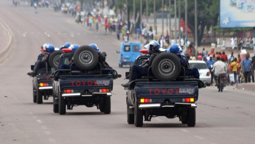 Congo riot police patrol streets on trucks, after violence erupted due to the delay of the presidential elections in Kinshasa, Democratic Republic of Congo, Tuesday, Sept. 20, 2016. More than 44 people have been killed in Congo in two days of street clashes between security forces and protesters, a senior Human Rights Watch researcher said Tuesday, and several opposition party buildings were burned. (AP Photo/John Bompengo)