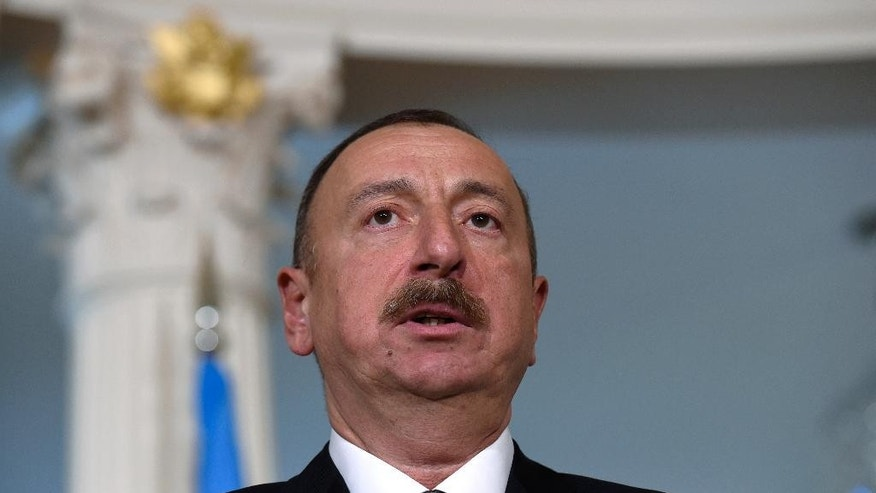 FILE - In this March 30, 2016 file photo, Azerbaijani President Ilham Aliyev makes a statement before a meeting with U.S. Secretary of State John Kerry at the State Department in Washington. A European law and human rights commission, in a report released on Wednesday, Sept. 21, 2016, has criticized proposed constitutional changes in Azerbaijan that would extend the president's term. (AP Photo/Susan Walsh, File)