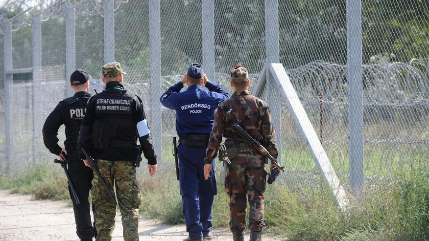 Hungarian and Polish soldiers and policemen patrol the Hungarian-Serbian border near Roszke, 180 kms southeast of Budapest, Hungary, Tuesday, Sept. 20, 2016. Two days earlier forty-nine Polish officers, including twenty-five policemen and twenty-four border guards arrived to Hungary to assist their Hungarian colleagues with border defence until October 29. The Polish contingent fulfills duty as part of the cooperation between the Visegrad Group (V4) countries. (Zoltan Gergely Kelemen/MTI via AP)