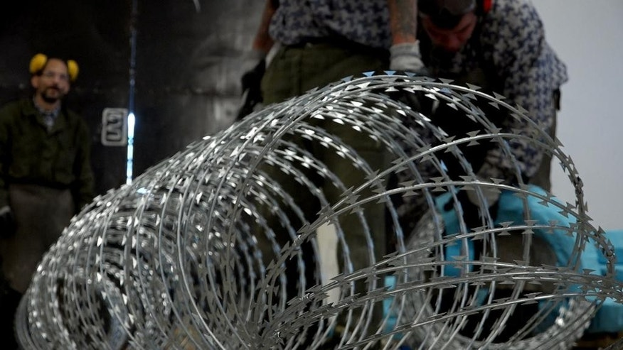 Prison inmates are manufacturing razor wire used on the fences Hungary has built on its borders with Serbia and Croatia to stop the flow of migrants and refugees, in Marianosztra, Hungary, Wednesday,. Sept. 21, 2016. Prime Minister Viktor Orban has announced plans for a second fence on the Serbian border against a possible surge of people along the Balkan route toward western Europe but rights advocates see the barrier as Hungary's first step in the dismantling of its asylum system. (AP Photo/Andras Nagy)