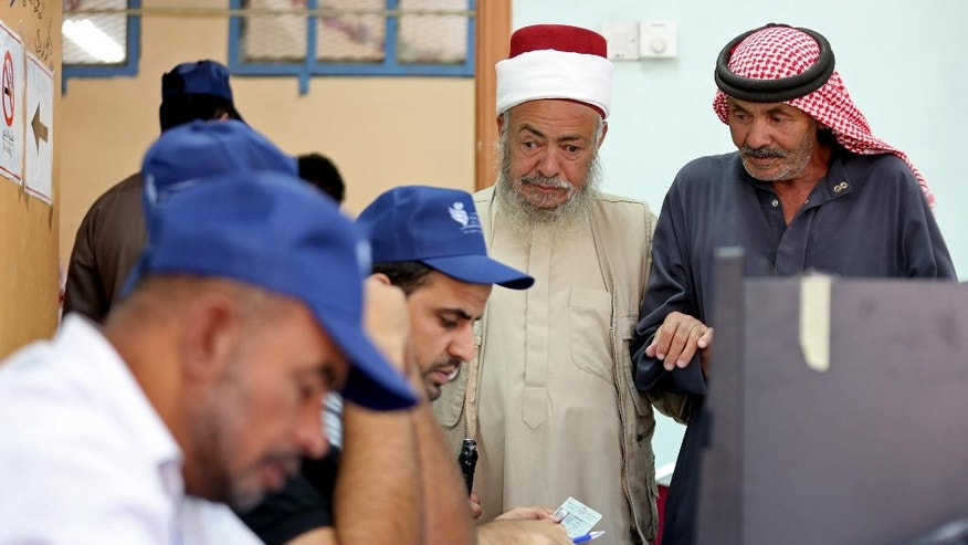 Jordanians vote in elections in Amman, Jordan, Tuesday, Sept. 20, 2016. Jordanians are voting for a new parliament under revised rules meant to strengthen political parties -- an election seen as a small step toward democratic reform. More than 4 million residents of the pro-Western monarchy are eligible to vote for a 130-member parliament, with 27 seats reserved for women, Christians and ethnic minorities. (AP Photo/Raad Adayleh)