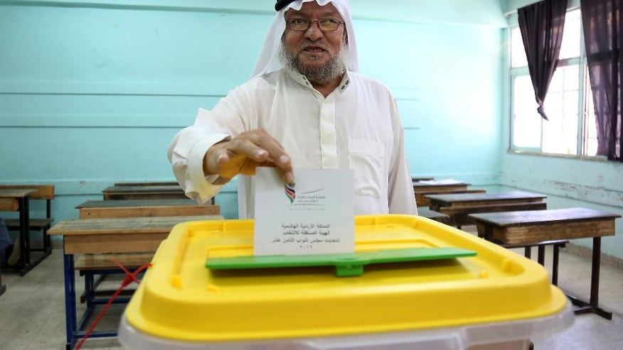 Jordanians vote in elections, Amman, Jordan, Tuesday, Sept. 20, 2016. Jordanians are voting for a new parliament under revised rules meant to strengthen political parties -- an election seen as a small step toward democratic reform. More than 4 million residents of the pro-Western monarchy are eligible to vote for a 130-member parliament, with 27 seats reserved for women, Christians and ethnic minorities. (AP Photo/Raad Adayleh)