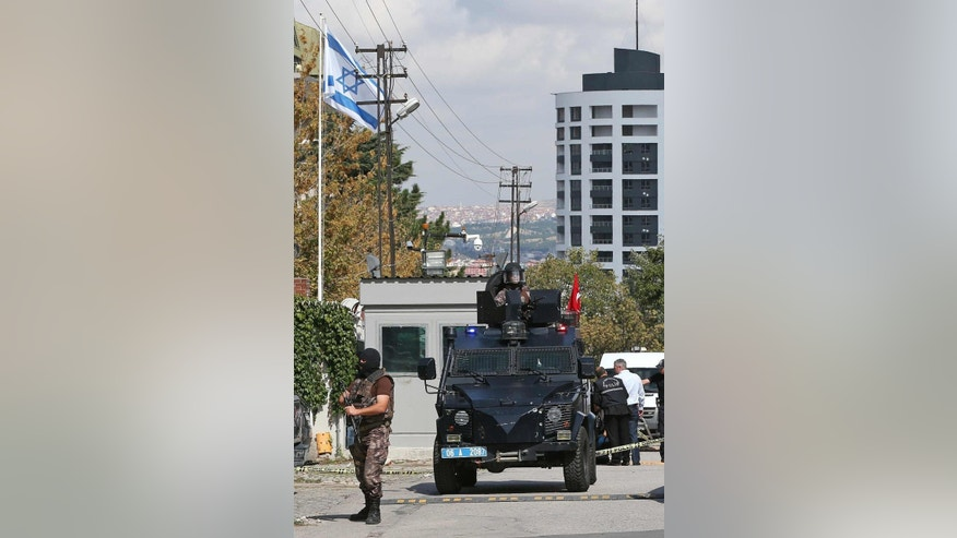 Armed forces near the scene outside the Israeli embassy in Ankara, Turkey where a solo attacker was shot and wounded Wednesday Sept. 21, 2016. (AP Photo/Burhan Ozbilici)