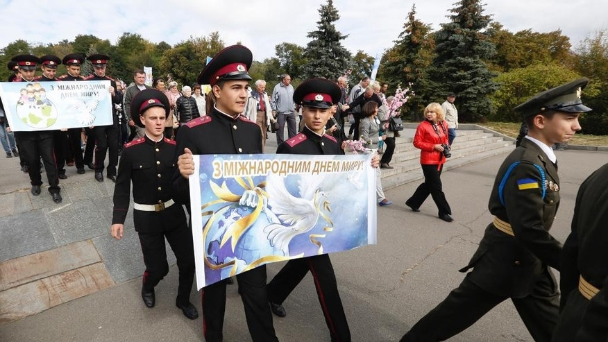Ukrainian lmilitary cadets take part in the Peace March in Kiev, Ukraine, Sept. 21, 2016, during the International Day of Peace. (AP Photo/Sergey Chuzavkov)