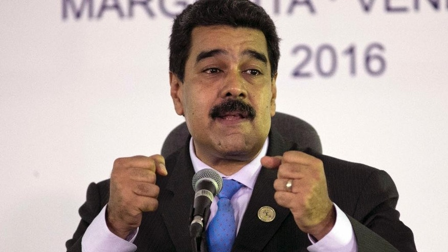 Venezuela's President Nicolas Maduro speaks during a press conference after closing ceremony of the 17th Non-Aligned Movement Summit in Porlamar, on Venezuela's Margarita Island, Venezuela, Sunday, Sept 18, 2016. In a closing address, Venezuela President Maduro said the UN should not only be reformed, it should be re-founded, with all nations on more equal footing.(AP Photo/Ariana Cubillos)