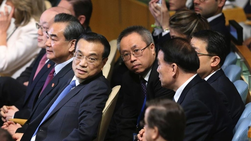 Chinese Premier Li Keqiang, second from left, listens to speeches during the 71st session of the United Nations General Assembly at U.N. headquarters, Wednesday, Sept. 21, 2016. (AP Photo/Seth Wenig)