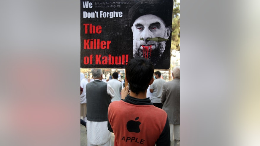 "An Afghan demonstrators holds a placard with an image of Gulbuddin Hekmatyar, the leader of Hizb-i-Islami Gulbuddin party, during a demonstration against him in a public park in Kabul, Afghanistan, Thursday, Sept. 22, 2016. The government has signed a draft peace deal with Hizb-i-Islami Gulbuddin, a designated ""global terrorist"" after lengthy negotiations that could pave the way for a similar accord with the Taliban. It grants full political rights to Gulbuddin's Hezb-i-Islami party and obliges the Afghan authorities to work to have it removed from the United Nations' list of foreign terrorist organizations. (AP Photo/Rahmat Gul)"