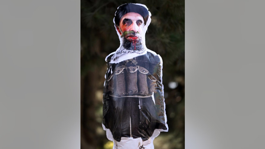 "An effigy of Gulbuddin Hekmatya, the leader of Hizb-i-Islami Gulbuddin party, is displayed during a demonstration against him in a public park in Kabul, Afghanistan, Thursday, Sept. 22, 2016. Afghanistan's government signed a draft peace deal on Thursday with a designated ""global terrorist"" after lengthy negotiations that could pave the way for a similar accord with the Taliban, who have been waging war on Kabul for 15 years. (AP Photo/Massoud Hossaini)"