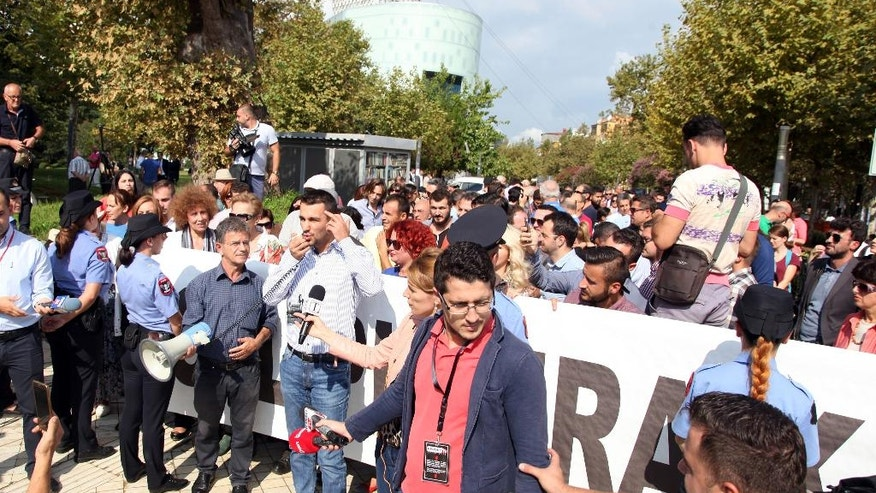 Environmental activists protest against a draft law on importing foreign rubbish, outside the Parliament building in Tirana, Albania, Thursday, Sept. 22, 2016. The law was opposed by the environmental activists and the opposition. The law was turned down by the left-wing governing coalition when they came to power in 2013. (AP Photo/Hektor Pustina)