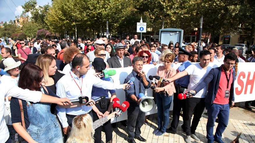 Environmental activists protest against a draft law on importing foreign garbage, outside the Parliament building in Tirana, Albania, Thursday, Sept. 22, 2016. The law was opposed by the environmental activists and the opposition. The law was turned down by the left-wing governing coalition when they came to power in 2013. (AP Photo/Hektor Pustina)