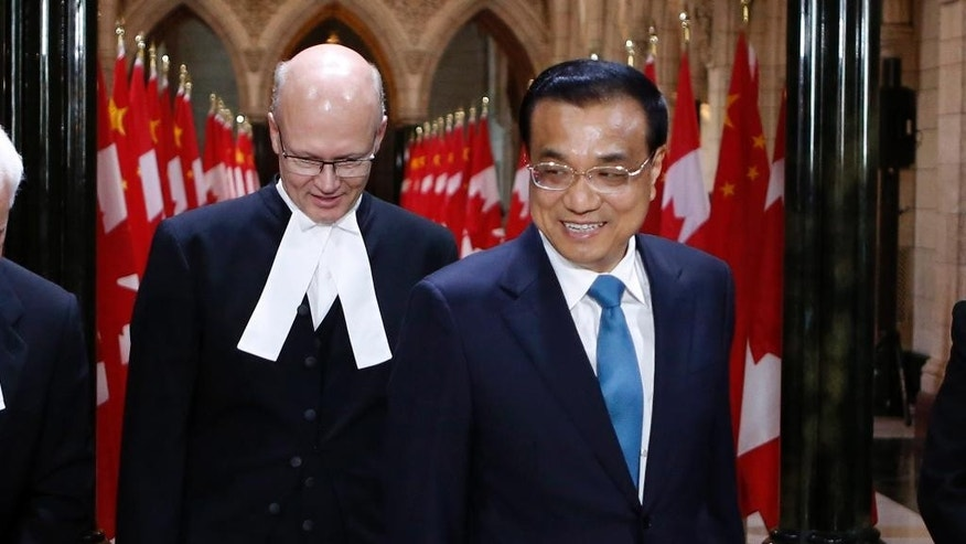Premier of the State Council of the People's Republic of China Li Keqiang is welcomed by House of Commons speaker Geoff Regan, left, in Ottawa on Thursday, September 22, 2016., 2016. THE CANADIAN PRESS/Fred Chartrand