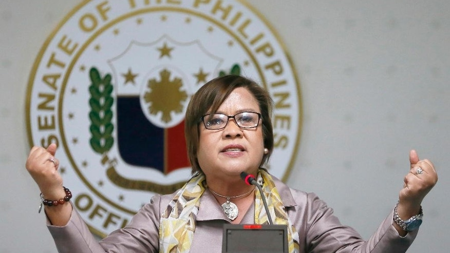 Opposition Senator Leila De Lima gestures during a news conference she called at the Philippine Senate, Thursday, Sept. 22, 2016, in Pasay city south of Manila, Philippines. De Lima, who led an investigation into President Rodrigo Duterte's bloody anti-drug campaign, was ousted Monday from the justice committee in a vote that human rights advocates said could derail accountability in the crackdown. (AP Photo/Bullit Marquez)
