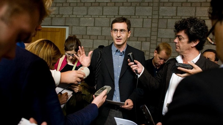 FILE - In this Sept. 10, 2008 file photo, Hasan Nuhanovic, whose father and brother were killed in Srebrenica, talks to the media after a judgment at the District Court in The Hague, Netherlands. A top European court on Thursday, Sept. 22, 2016, dismissed a case brought by relatives of three Bosnian men, two of them relatives of Hasan Nuhanovic, who were murdered during the 1995 Srebrenica massacre. The relatives had appealed a decision by Dutch prosecutors not to file criminal charges against three Dutch officers for alleged complicity in the deaths. (AP Photo/ Fred Ernst, File)