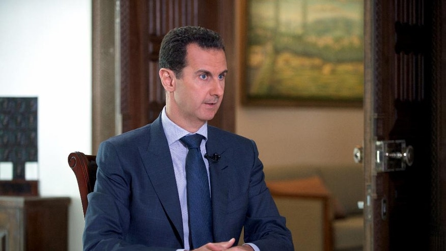 "In this Wednesday, Sept. 21, 2016 photo released by the Syrian Presidency, Syrian President Bashar Assad speaks to The Associated Press at the presidential palace in Damascus, Syria. Assad said U.S. airstrikes on Syrian troops in the country's east were ""definitely intentional,"" lasting for an hour, and blamed the U.S. for the collapse of a cease-fire deal brokered with Russia. In the interview with the AP, Assad said the war, now in its sixth year, is likely to ""drag on"" because of what he said was continued external support for his opponents.(Syrian Presidency via AP)"
