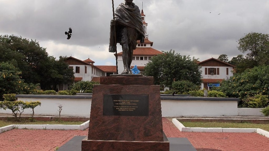 A statue of Indian independence leader Mahatma Gandhi in Accra, Ghana, Thursday, Sept. 22, 2016. Professors at a university in Ghana's capital are campaigning for the removal of a new statue of Indian independence leader Mahatma Gandhi. (AP Photo/Christian Thompson)