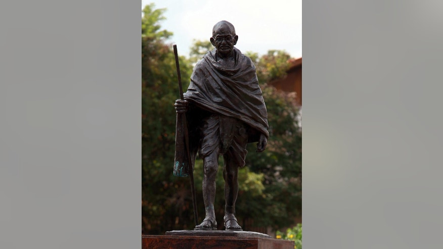 A statue of Indian independence leader Mahtama Gandhi in Accra, Ghana, Thursday, Sept. 22, 2016. Professors at a university in Ghana's capital are campaigning for the removal of a new statue of Indian independence leader Mahatma  Gandhi.(AP Photo/Christian Thompson)