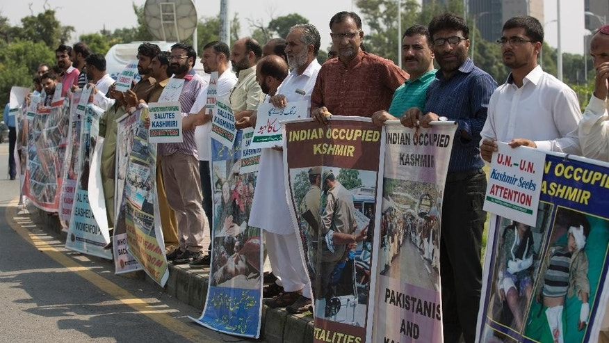 "Supporters of Kashmiri party, All Parties Hurriyat Conference, gather to express their solidarity with Kashmiris resisting Indian rule, in Islamabad, Pakistan, Thursday, Sept. 22, 2016. Pakistan's Prime Minister Nawaz Sharif has strongly criticized suppression of protests by archrival India in the disputed territory of Kashmir, during his speech in the UN General Assembly. Sharif called Wednesday for an independent inquiry into extra-judicial killings and a U.N. fact-finding mission to investigate what he termed ""brutalities."" (AP Photo/B.K. Bangash)"