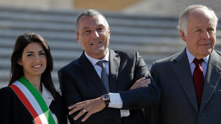 From left; Rome's mayor Virginia Raggi, left, Jean-Christophe Babin, CEO of Bulgari jewelry house, and Nicola Bulgari, great-grandson of the Bulgari founder, pose for photographers at the world-famous Spanish Steps ahead of a press conference to present the reopening of the site at the end of a 10-month restoration in which Bulgari jewelry house participated, in Rome, Thursday, Sept. 22, 2016. The Spanish Steps will open again to the public on Friday. (AP Photo/Andrew Medichini)