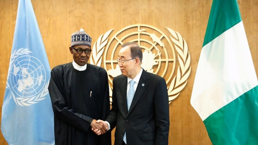 FILE- In this Wednesday, Sept. 21, 2016 file photo Nigerian President Muhammadu Buhari meets United Nations General Secretary-General Ban Ki-moon at U.N. Headquarters in New York City, NY, USA Nigeria's President Muhammadu Buhari has invited the United Nations to help negotiations to swap of the kidnapped schoolgirls from Chibok for detained leaders of Boko Haram, a government statement said Thursday Sept. 22, 2016. (AP Photo/Mary Altaffer, File)