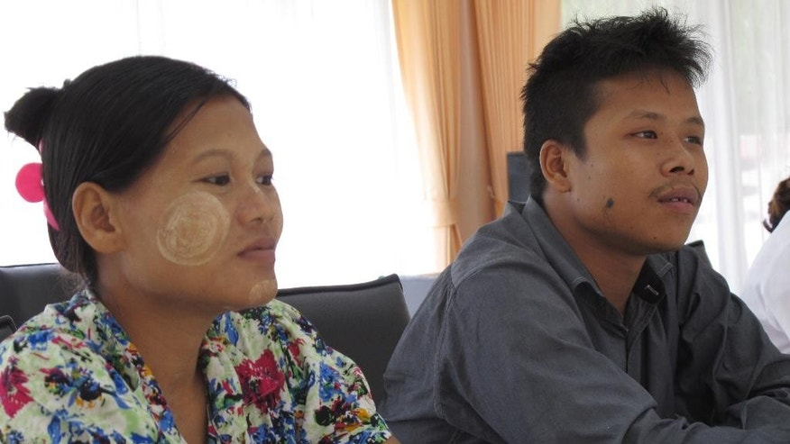FILE - In this June 24, 2016, file photo, Burmese former shrimp shed worker Tin Nyo Win, right, sits next to his pregnant wife Mi San during an interview in Pathum Thani, Thailand. Tin Nyo Win, who escaped slavery and alerted police to abuses, was deported to Myanmar, along with Mi San and a half-dozen others, after being held almost a year in a Thai government shelter. Authorities said that although the couple were victims of modern-day slavery, they had illegally entered Thailand to begin with. (AP Photo/Margie Mason, File)