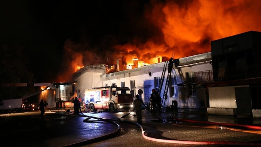 In this photo provided by Emergency Situations Ministry press service, firefighters work at the scene of a large blaze at a plastic warehouse in Moscow, Russia, Friday Sept. 23, 2016, with about 300 firefighters attending the incident  Emergencies Ministry said eight firemen died while tackling the blaze which started Thursday.  ( Russian Emergency Ministry press service photo via AP) MANDATORY CREDIT