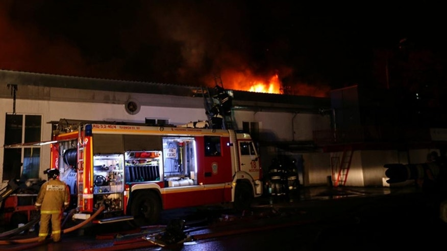 In this photo provided by Emergency Situations Ministry press service firefighters prepare to extinguish a large blaze at a plastic warehouse, reportedly stored a wide range of plastic goods, including artificial flowers, early Friday, Sept. 23, 2016. The Emergencies Ministry said that eight firemen died while trying to extinguish the blaze. ( Russian Emergency Ministry press service photo via AP)