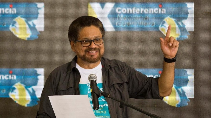 Ivan Marquez, chief negotiator of the Revolutionary Armed Forces of Colombia, FARC, announces that the group's 10th conference ratified the peace deal with the Colombian government in Yari Plains, southern Colombia, Friday, Sept. 23, 2016. FARC leaders on Friday gave their unanimous support to the peace agreement at their final conference as a guerrilla army. (AP Photo/Ricardo Mazalan)