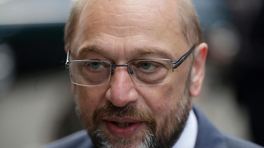 CAPTION CORRECTS THE DAY - The President of the European Parliament Martin Schulz gives a television interview in German after his talks with British Prime Minister Theresa May at 10 Downing Street in London, Thursday, Sept. 22, 2016. (AP Photo/Matt Dunham)